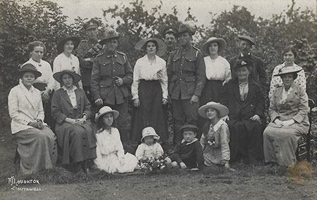 Two Australian soldiers posse with a group